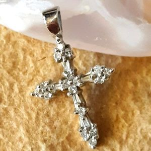 Jewelry - 10K white gold and diamond cross pendant.